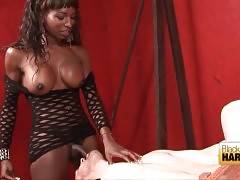 Black t-mistrees slaps dude`s chest and butt cheeks with her whip.