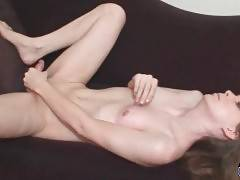 Slutty tranny lubes her hand and massages her dong.