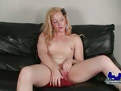 Plump blonde tranny poses and tenders herself.