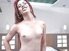 Naughty brazilian tranny lies down on bed for some solo action.
