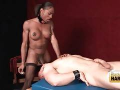 Hungry black shemale gives her bone to tied dude.