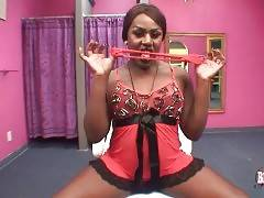 Black tranny takes her tiny red panties off and spreads legs.