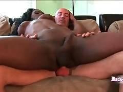 Naughty black shemale rides hard white dick.