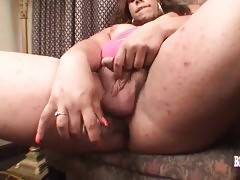 Turned on ebony shemale stimulates her dick and ass.