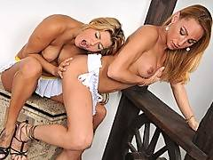 At the beginning of this scene we see two gorgeous and statuesque blonds touching one another, dressed only in their bikinis.  However, you`re going to get one hell of a surprise as one of the blond babes pulls down her panties and a huge cock springs out