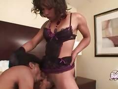 Skinny black guy hungrily slurps she-male`s hard black dong.