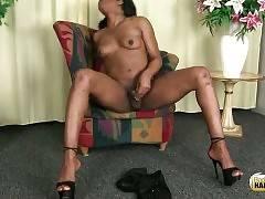 T-ebonie spreads her longs legs in high heels and plays her dick.