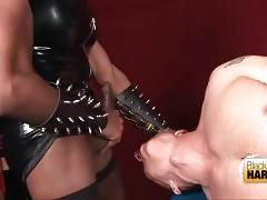 Black shemale makes tied dude suck her dick.