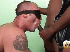 Dominating ebony shemale fucks guy`s mouth and fingers his ass.