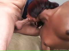 Naughty black shemale gives her white lover blowjob.